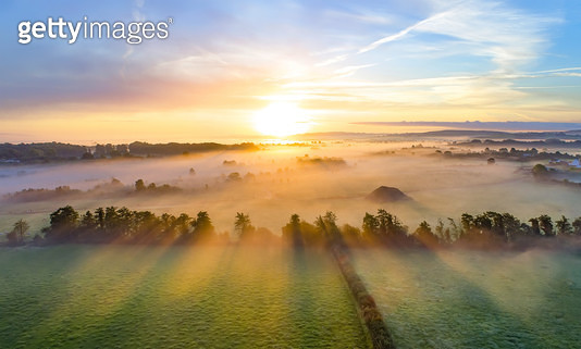 Colorfull sunrise on foggy day over Tipperary mountains and fields. - gettyimageskorea