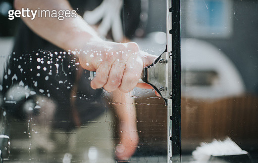 Man washing Window - gettyimageskorea