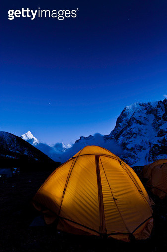 Yellow dome tent starry sky mountain peaks Himalayas Nepal - gettyimageskorea