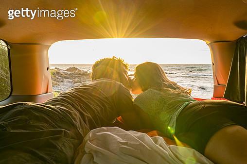 Couple kissing in a van, New Zealand. - gettyimageskorea