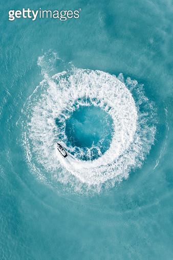 Jet ski doing circles shot by drone, Barbados - gettyimageskorea