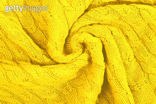 Knitted sweater as a trendy bright illuminating yellow and grey colours  background. - gettyimageskorea