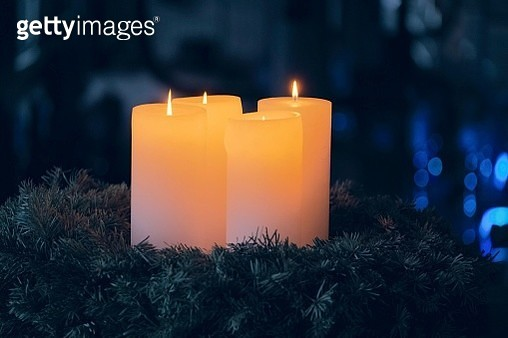Close-Up Of Illuminated Candles During Christmas - gettyimageskorea