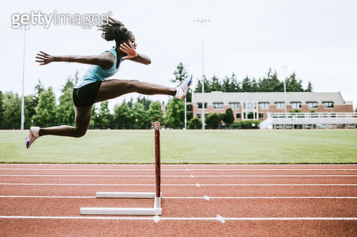 Woman Athlete Runs Hurdles for Track and Field - gettyimageskorea