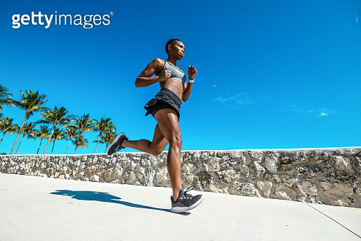 Hispanic or Afro Caribbean woman jogging in the morning near the beach in USA - gettyimageskorea