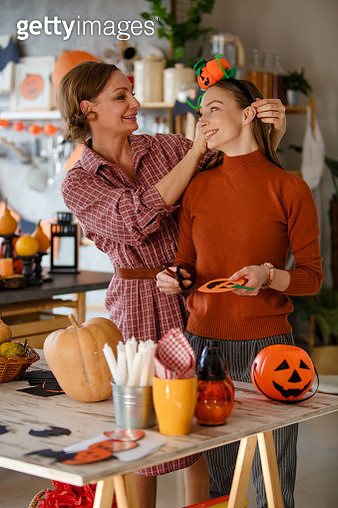 Mother and daughter enjoying preparations for Halloween, having nice time together. - gettyimageskorea