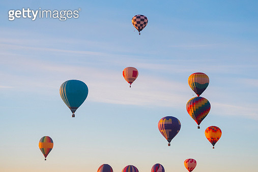 Hot air balloons flying in sky - gettyimageskorea