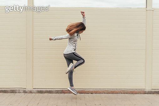 Fitness sport girl in fashion sportswear doing yoga fitness exercise in the street, outdoor sports, urban style - gettyimageskorea