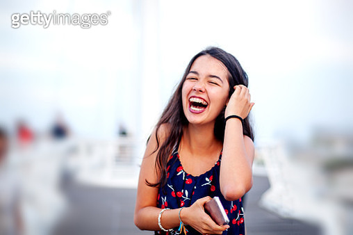 beautiful brunette girl  laughing in a wooden blue wall.Copyspace - gettyimageskorea