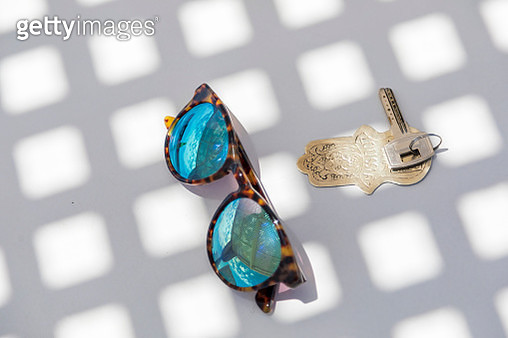 Close-up of sunglasses and key with ornate keychain. Marrakesh, Marrakesh-Safi, Morocco. - gettyimageskorea