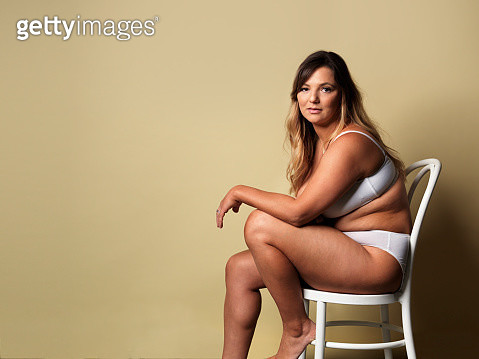 young woman sitting on chair - gettyimageskorea