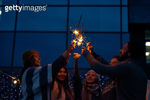 Dreamy friends making wish at Christmas night - gettyimageskorea