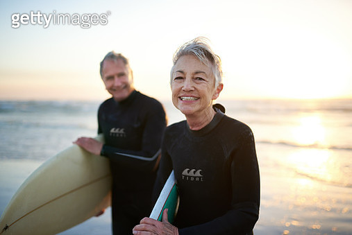 Cropped shot of a senior married couple coming from surfing - gettyimageskorea