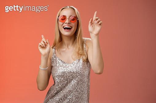 Amused attractive happy smiling woman dancing nightclub having fun - gettyimageskorea