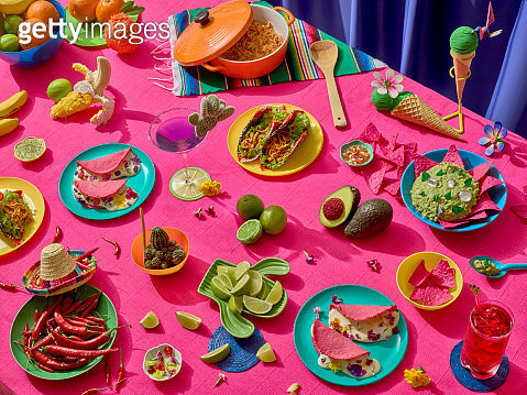 Mexican feast. A big table full of mexican platters in bright colors - gettyimageskorea