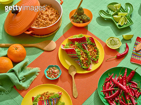 A platter of tacos wrapped into a a mexican handcrafted fabric. - gettyimageskorea