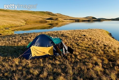 Camping in a tent, Saylyugem Mountains, Chuya Steppe, Altai Republic, Siberia, Russia - gettyimageskorea