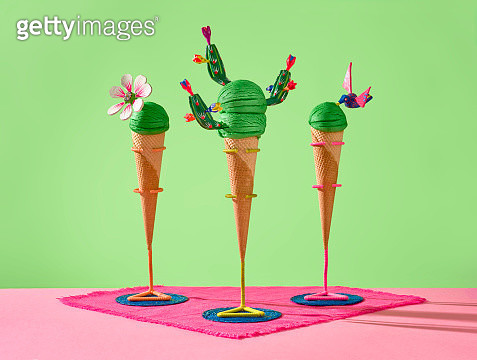3 green ice cream balls with green balls of ice cream decorated with Mexican handcrafts. - gettyimageskorea