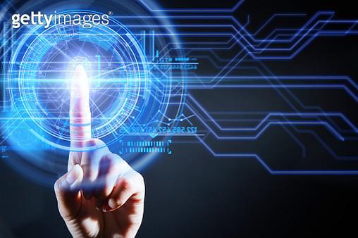 Woman's index finger touching a digital scanner and scanning her fingerprint. - gettyimageskorea