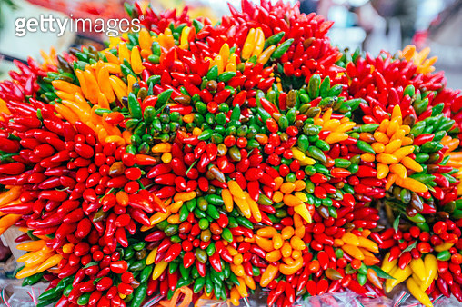 Bunch of colorful chili peppers at the Rialto Bridge market in Venice, Italy - gettyimageskorea