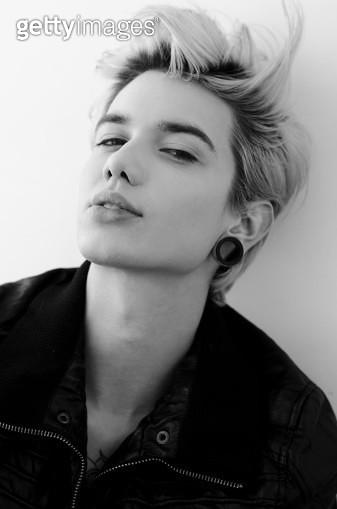 Portrait of androgyny blond guy, studio shot - gettyimageskorea