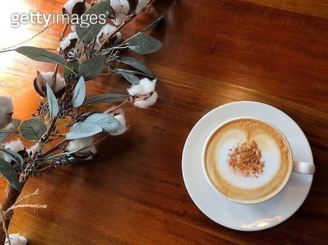 High Angle View Of Coffee Cup And Plant On Table - gettyimageskorea