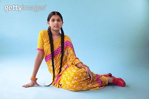 Indian teenage girl sitting in Saree - gettyimageskorea