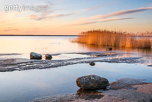 Scenic view of lake at sunset - gettyimageskorea