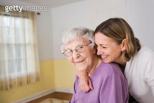 Daughter hugging Elderly mother - gettyimageskorea