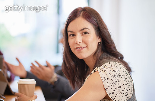 Smiling businesswoman in modern office - gettyimageskorea