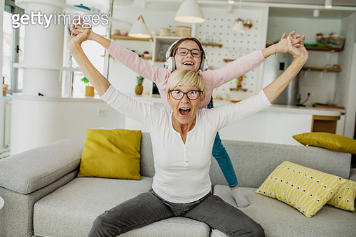 A little girl having a great time with her grandmother - gettyimageskorea