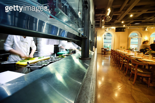 Wide angle view of a high end restaurant.Chefs working on kitchen and guests waiting for dinner. - gettyimageskorea