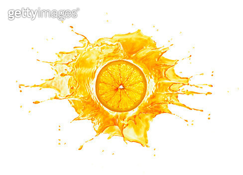 Big splash with orange slice in the middle. lit up from behind, Isolated on white background. - gettyimageskorea