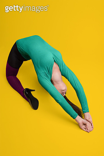 Woman Exercising Against Yellow Background - gettyimageskorea