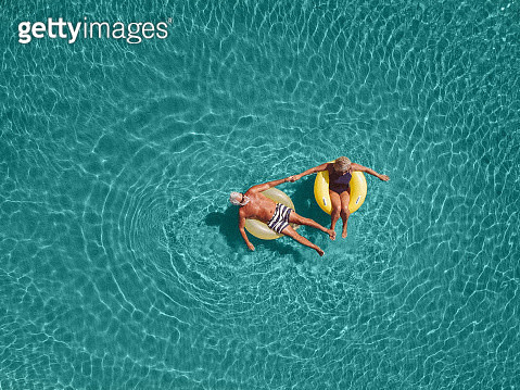 Senior couple enjoy sea water - gettyimageskorea