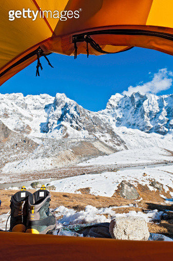 Mountain dome tent looking onto snowy peaks Himalayas Nepal - gettyimageskorea