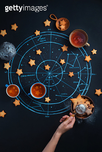 Stargazers teatime with astrological and astronomical symbols. Chalk map of the starry sky. Creative food photography flat lay - gettyimageskorea