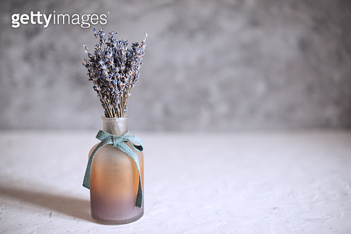 Lavender flowers in a glass vase on a table - gettyimageskorea