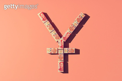 Still life of folded chinese yuan notes making a shape of the yuan currency sign. - gettyimageskorea