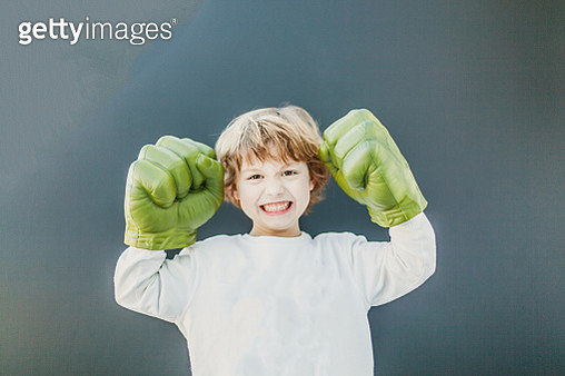 boy playing at home in toy fists - gettyimageskorea
