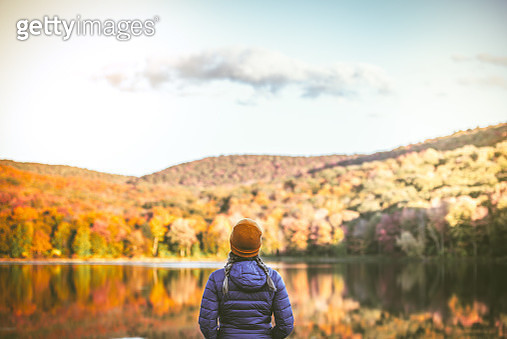 Young Woman in Autumn Landscape. - gettyimageskorea