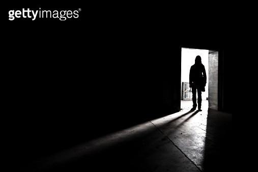 Silhouette shadow of man in doorway - gettyimageskorea