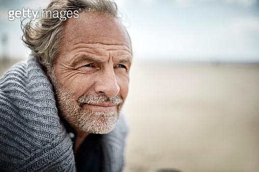Portrait of mature man on the beach - gettyimageskorea