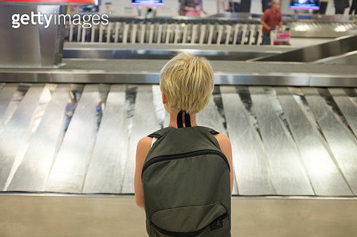 Girl at airport - gettyimageskorea