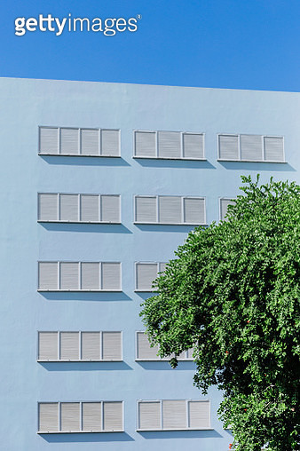 Repetitive facade in a blue building - gettyimageskorea