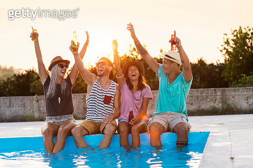 Friends sitting by the swimming pool - gettyimageskorea