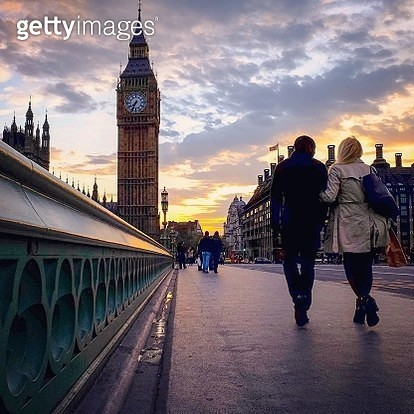 Rear View Of Couple Walking On Westminster Bridge By Big Ben Against Sky During Sunset - gettyimageskorea