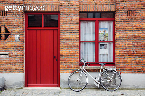Bike parked near house in Bruges, Belgium - gettyimageskorea