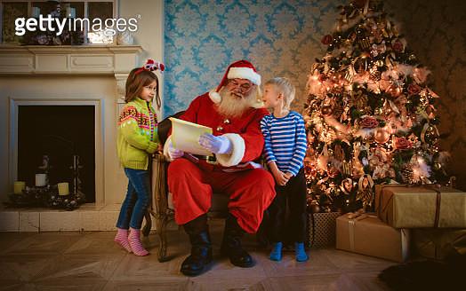 Happy kids opening their Christmas presents - gettyimageskorea