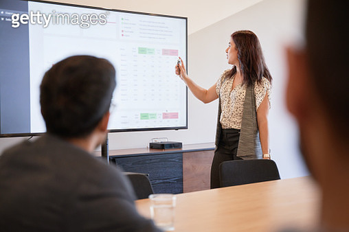 Businesswoman using graphs on screen in business meeting - gettyimageskorea